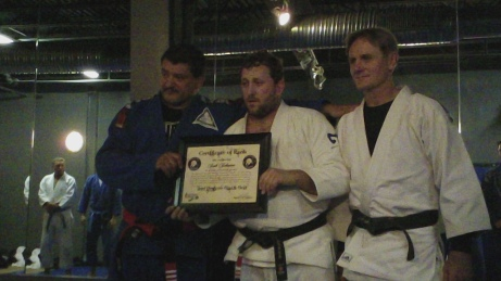 Here I am pictured with Master Palhares on my right and Eb Kieslich Sensei to my left.  I just accepted my certification as a 2nd degree black belt in The Luiz Palhares Brazilian Jiu-Jitsu Association!