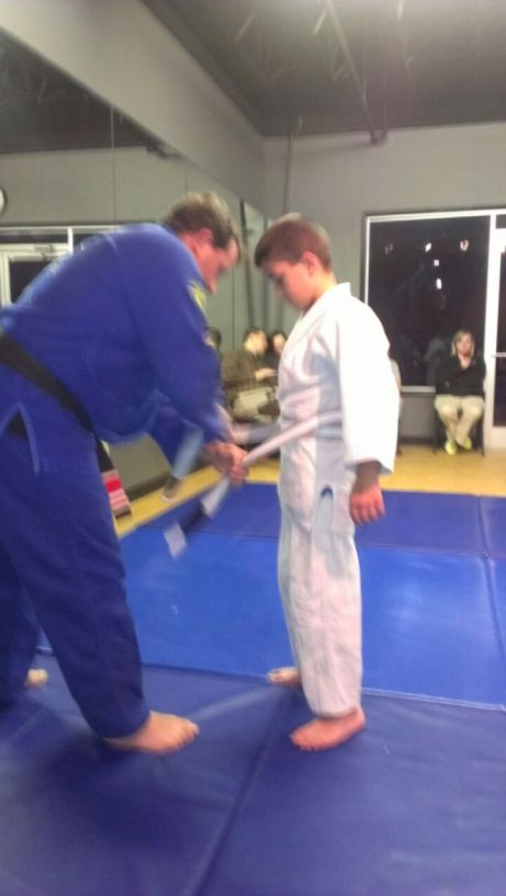 Jayden getting the grey/white belt