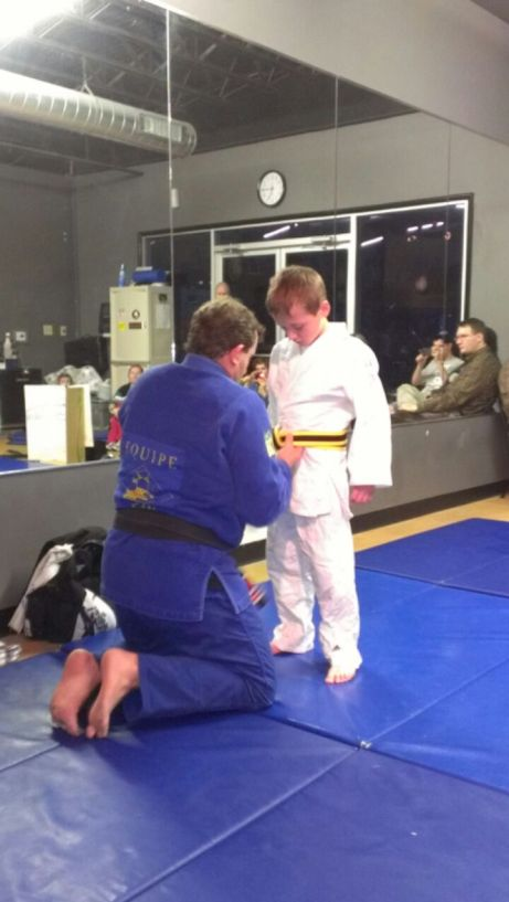Bryant with the yellow/black belt