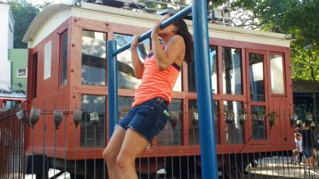 Bored in Brasil....Shannon goes to hit a couple sets of pull-ups in the park